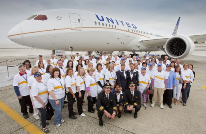 United Airlines staff in front of an aircraft